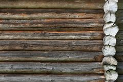 Wooden wall from logs old as background texture Stock Image