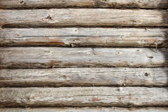 Wooden wall made from logs with nail. Background texture Royalty Free Stock Images