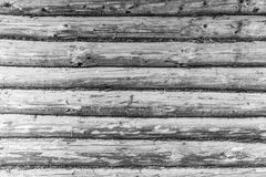 Wooden wall made from logs. Wood black white texture background. Stock Photography