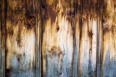 Wooden wall made of stained brown vertical battens Stock Photos