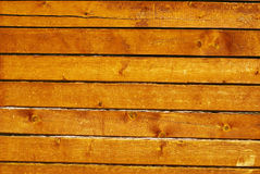 Wooden wall of natural cedar beams Stock Photography