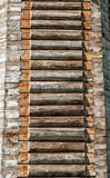 Wooden wall. The wall of the old house of thick logs Royalty Free Stock Image