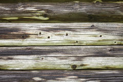Wooden wall of the old log house Royalty Free Stock Image