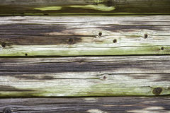 Wooden wall of the old log house Stock Photos