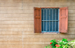 Wooden wall with old window. Royalty Free Stock Images