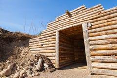 Wooden wall and open door of old underground sauna Stock Photo