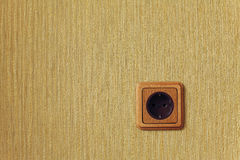 Wooden wall outlet Stock Image