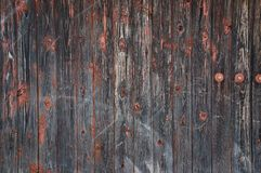 Wooden wall. From the paint remains Stock Image