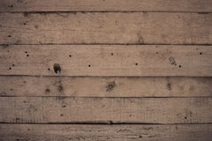 Wooden wall with paint is severely weathered and peeling Stock Images
