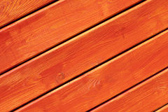 Wooden wall painted in bright orange Royalty Free Stock Images