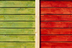 Wooden wall painted in green and bright orange Royalty Free Stock Image