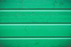 Wooden wall painted green texture Stock Images