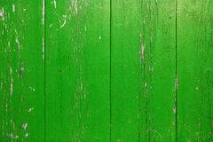 Wooden wall with peeling green paint. Surface of vertical wooden planks covered with weathered green paint stock images