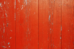 Wooden wall with peeling red paint. Surface of vertical wooden planks covered with weathered red paint stock images