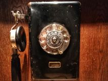 Wooden wall phone. Decorative wooden wall telephone stock photo