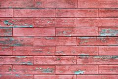 Wooden wall with red horizontal boards laid in the form of brick Royalty Free Stock Image