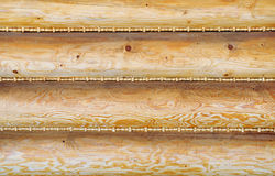 Wooden wall. Sealed with straw plaits stock photography