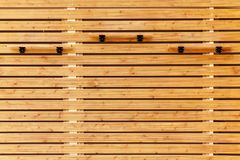 Wooden wall with shelves Royalty Free Stock Photo