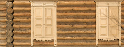 Wooden wall shuttered windows Stock Photography
