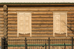 Wooden wall shuttered windows Stock Image