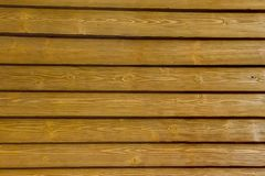 Wooden wall slats. Bright wooden wall with slats Stock Images