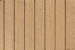 Wooden Wall Texture Background. Wooden wall planks in golden brown on a sunny day.  Background Texture Stock Image