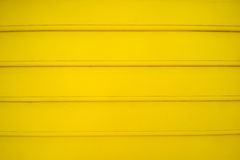 Wooden wall texture. Yellow wooden wall texture with horizontal line stock image