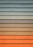 A wooden wall with a various amount of colors. Painted on it stock images