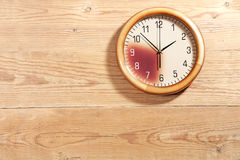 Wooden wall with watch Royalty Free Stock Photos