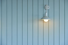 Wooden wall with white lamp Royalty Free Stock Image