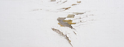 Wooden wall with white paint is weathered and peeling Royalty Free Stock Image