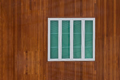 Wooden wall with white window frame Stock Image