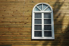 Wooden wall with white window Stock Photos