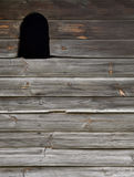 Wooden wall with a window on it Stock Photos