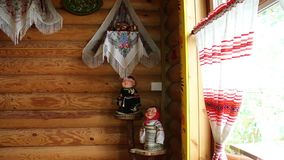 Wooden wall and window decorated in Russian style. Dolls, toys, shawls, wooden products. stock video footage