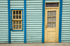 Wooden wall with window and door. Blue wooden wall with window and door stock photos