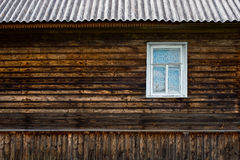 Wooden wall with window Royalty Free Stock Image