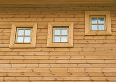 Wooden wall with windows Royalty Free Stock Images