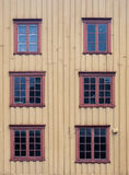 Wooden wall with windows Stock Image