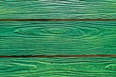 Wooden walls painted bright green And with an eye on the wooden Stock Images