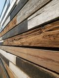 Wooden walls. Strips of weathered mismatched wood make up the walls of a corridor in a church Stock Photo