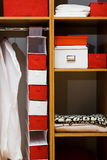 Wooden wardrobe. Clothes and towels in a wooden wardrobe Stock Photography