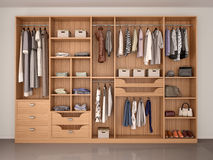 Wooden wardrobe closet full of different things. Stock Image