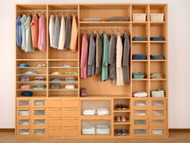 Wooden wardrobe closet full of different things. Royalty Free Stock Image