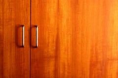 Wooden wardrobe doors close up. The wooden wardrobe doors close up Royalty Free Stock Photos