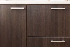 A wooden wardrobe drawer front, metal handle. Stock Photo