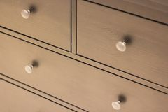 A wooden wardrobe drawer front, metal handle stock image