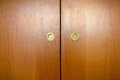 Wooden wardrobe handles stock images