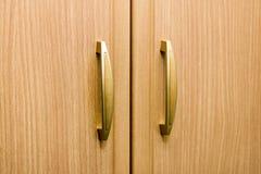 Wooden wardrobe knobs Stock Image