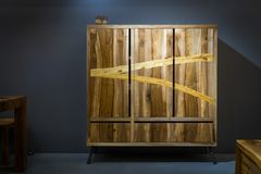 Wooden wardrobe made of different kinds of wood using variorus w Royalty Free Stock Images